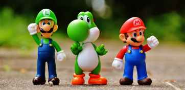 focus photo of super mario luigi and yoshi figurines